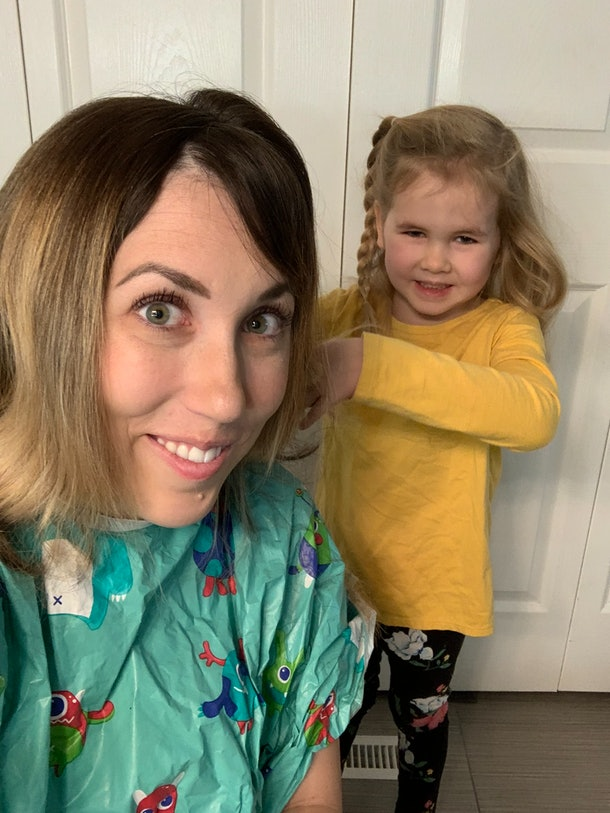 Mom receives haircut from toddler