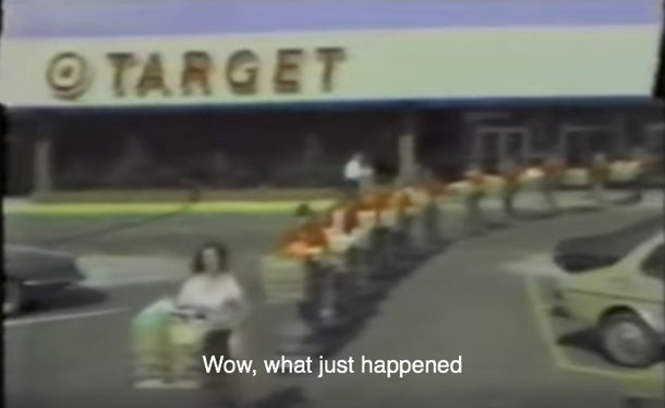 mom leaving Target with multiple shopping carts