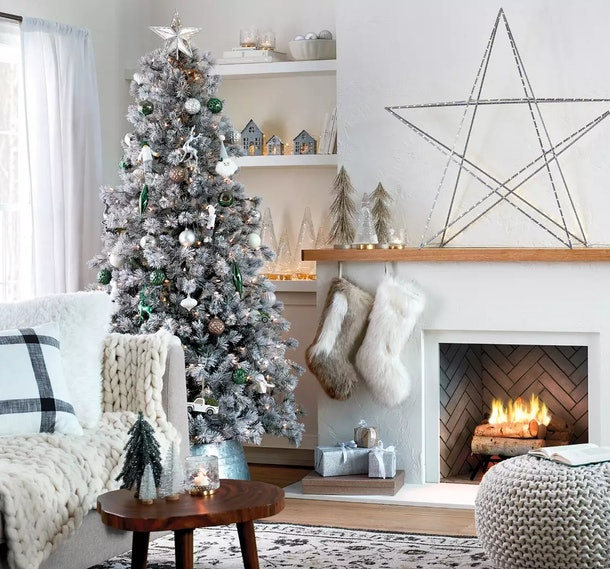Target Christmas Decor Weekend Deal; neutral living room decorated with grey, silver, gold, and white holiday decor with a Christmas tree