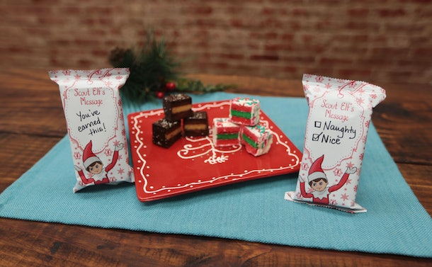 Elf On The Shelf Cake Bites with handwritten notes on the packaging