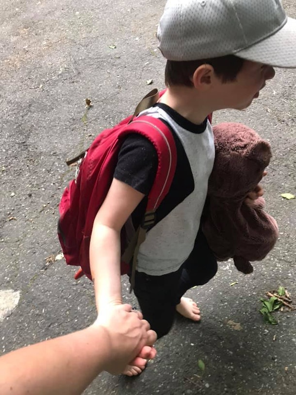 A picture of the author holding her son's hand.