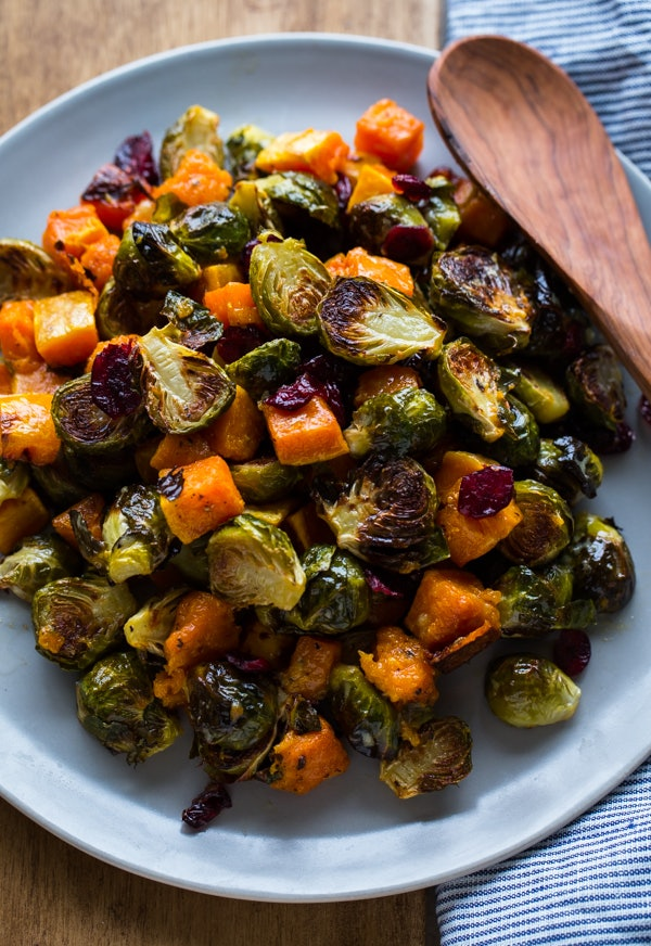 sheet pan thanksgiving sides, roasted brussels sprouts squash dried cranberries dijon vinaigrette