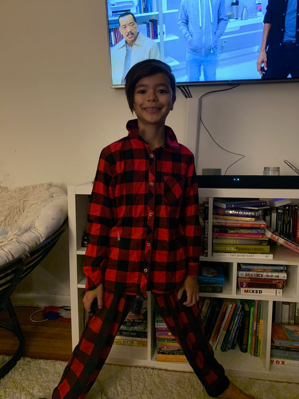 The cutest tiny human in head-to-toe buffalo check