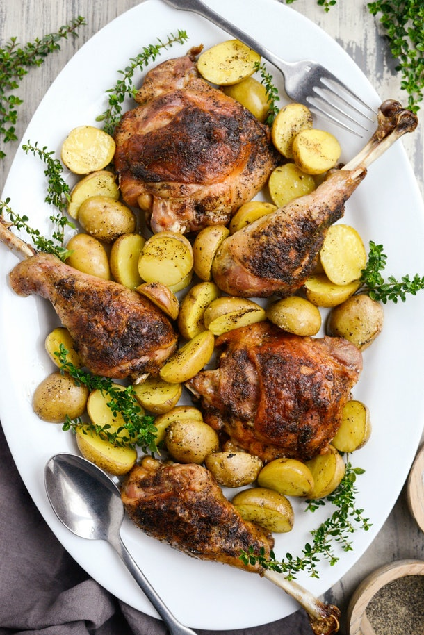 roasted sheet pan turkey and potatoes on white platter