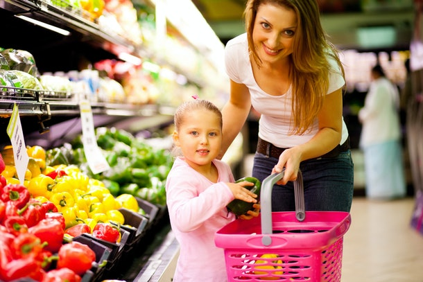girl shopping with mom for groceries