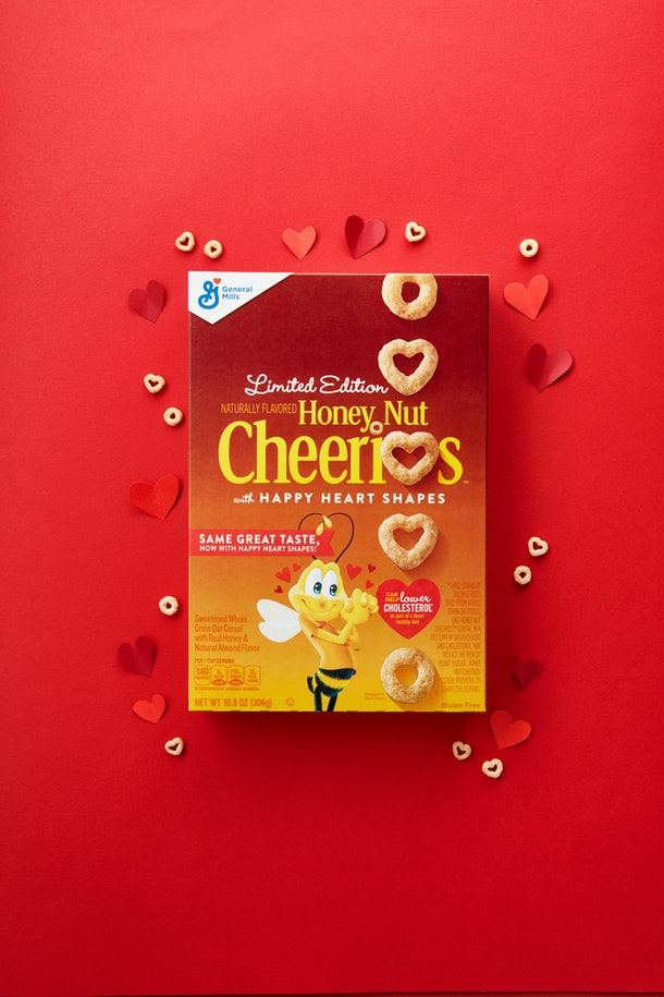 Heart shaped cheerios box on red background