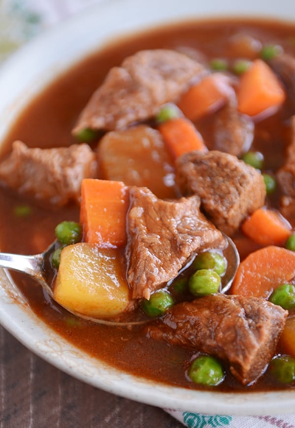 Close up of spoon scooping beef stew