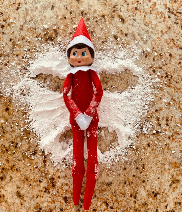 Elf on the Shelf powdered sugar snow angel