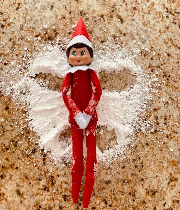 Elf on the Shelf powdered sugar snow angel