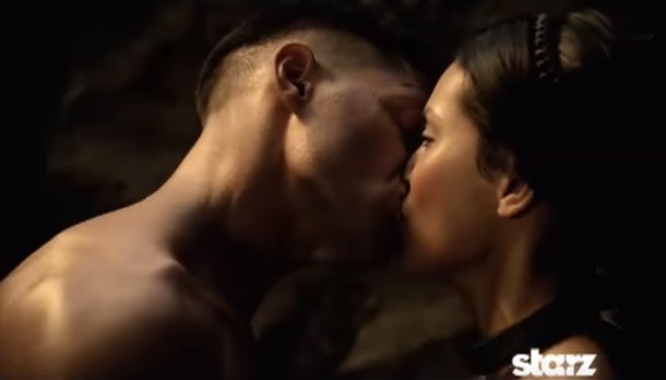 An image of a soldier kissing a woman.