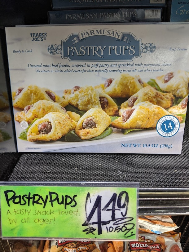 Trader Joe's display of packed, pre-made, frozen Parmesan pastry puffs
