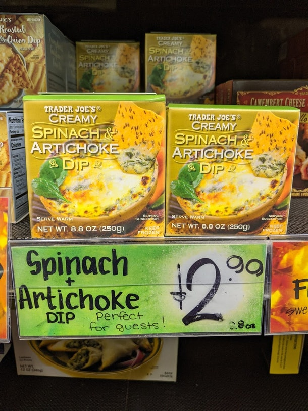 Trader Joe's display of packed, pre-made, frozen spinach & artichoke dip