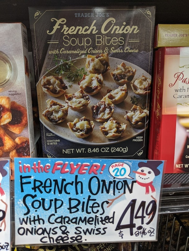Trader Joe's display of packed, pre-made, frozen French Onion Soup Bites with caramelized onions & swiss cheese