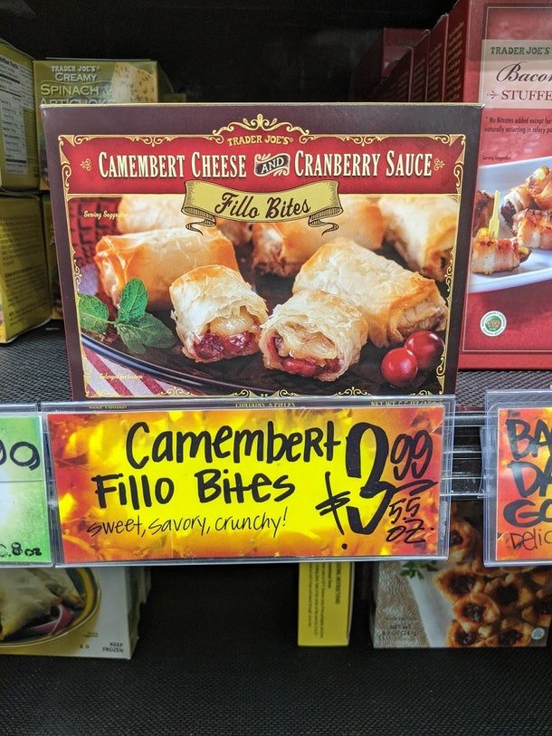 Trader Joe's display of packed, pre-made, frozen Camembert Fillo Bites