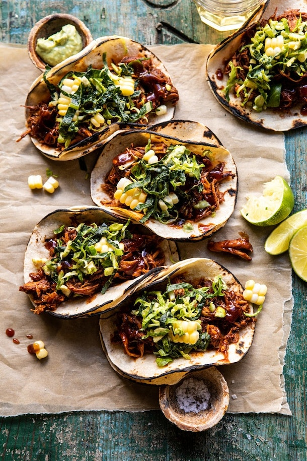 open faced tacos with shredded chicken, lettuce, and corn