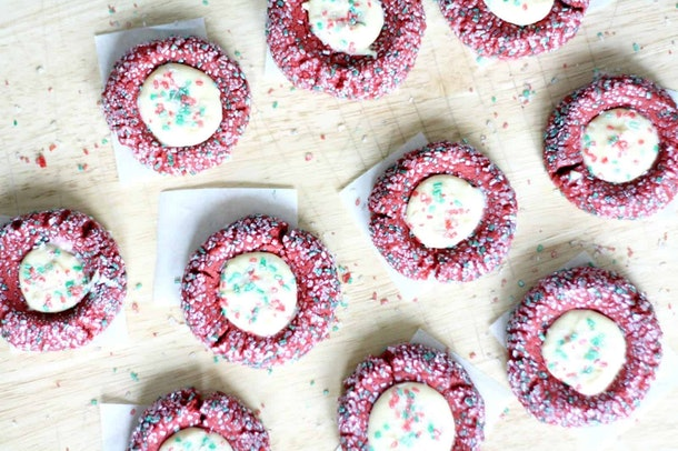 Red velvet crinkle cookies meet cheesecake topping in this unique cookie recipe.
