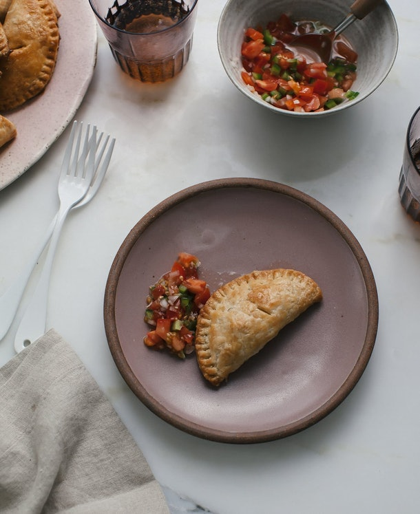 A baked empanada with beef filling is a perfect sheet pan recipe for kids.
