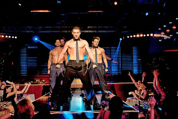In Magic Mike, Channing Tatum and his back-up dancers perform on stage in front of cheering women.