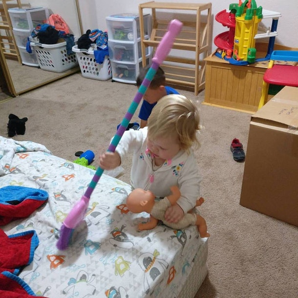 A child sweeps a bed