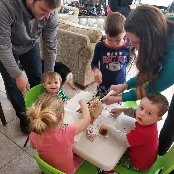 Children at a table helped by adults