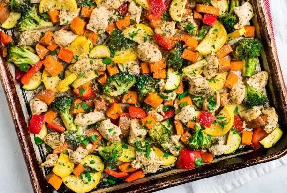 Sheet pan chicken with rainbow vegetables recipe from Well Plated by Erin is a fast, healthy, kid-approved meal