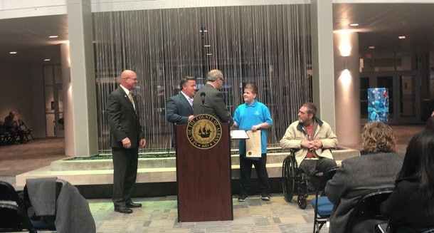 """A picture of young Josh Cudzey being awarded the """"Citizen of the Day,"""" award."""