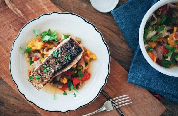 Foil cook some veggies as a perfect sea bass accompaniment.