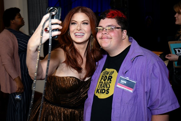Debra Messing and Gavin Grimm take a selfie together at the 2019 DoSomething Gala  in April 2019 in New York City.