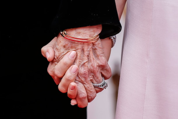 Laura Dern (R) and her mother Diane Ladd hold hands as they arrive for the 92nd annual Academy Awards ceremony at the Dolby Theatre in Hollywood, California, USA, 09 February 2020. T