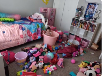 A little girl left her playroom dirty but put herself away and her mom got the picture.