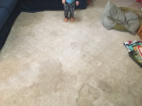 A dirty carpet and some toddler feet