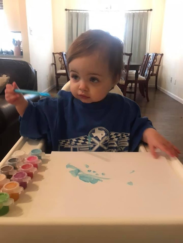 Finger painting in a high chair is one way kids are entertaining themselves during social distancing.