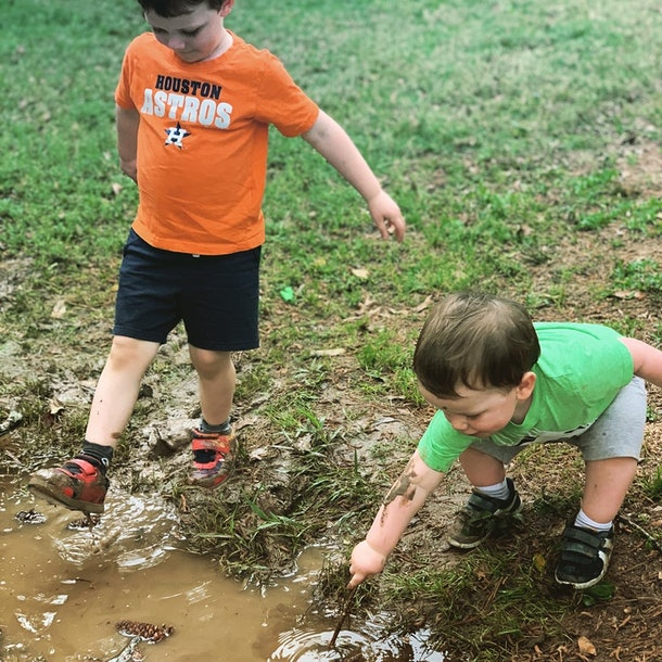 Playing in the mud is one way kids are entertaining themselves during social distancing.