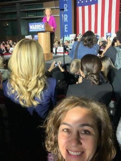 Elizabeth Warren stands in front of a crowd on Super Tuesday