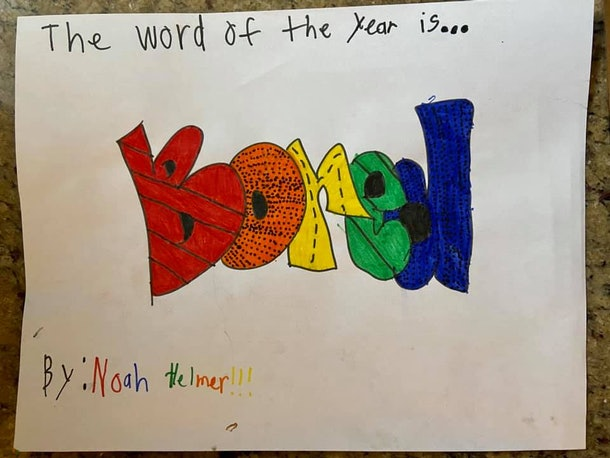 "The words ""The word of the year is... BORED!"" written artistically in marker."