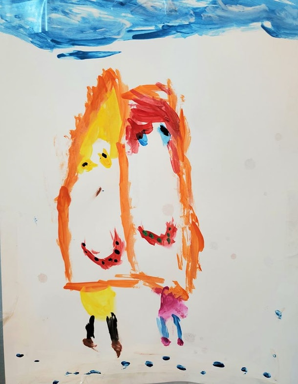 A child's drawing of two children.
