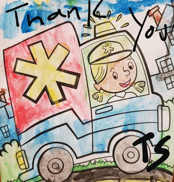A coloring book picture of a person driving an ambulance, painted with watercolors.