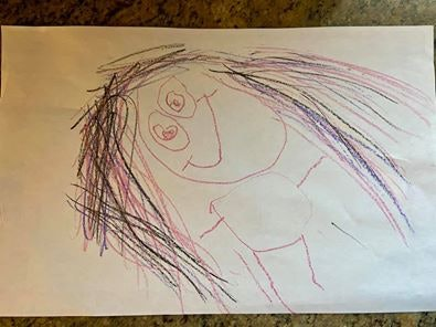 Child's drawing of a woman.