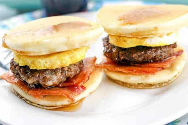 Close up of pancake sliders with bacon, egg, and sausage