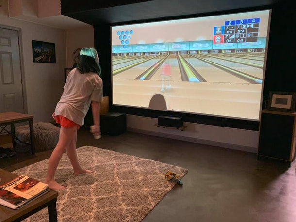 Kids can entertain themselves in quarantine by playing video games like Wii bowling.