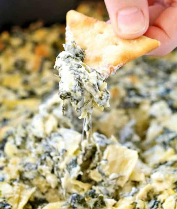 Spinach and artichoke dip recipe from Princess Pinky Girl is made in the crock pot and perfect for holiday entertaining