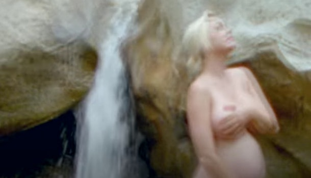 """Katy Perry shared a glimpse of her bare pregnancy bump in the music video for her new song """"Daisies""""."""