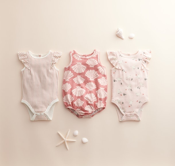 Even the bodysuits have sweet details, like ruffles on the shoulders and soft, pretty colors.