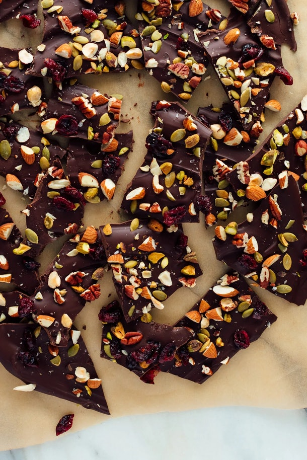 Dark brown chocolate slabs dotted with nuts and raisins.