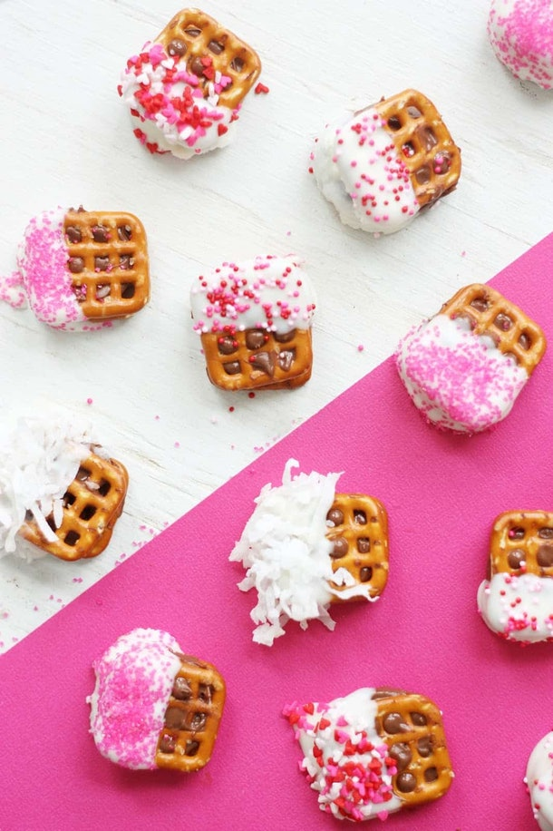 Mini pretzel squares dipped in chocolate and rolled in sprinkles.
