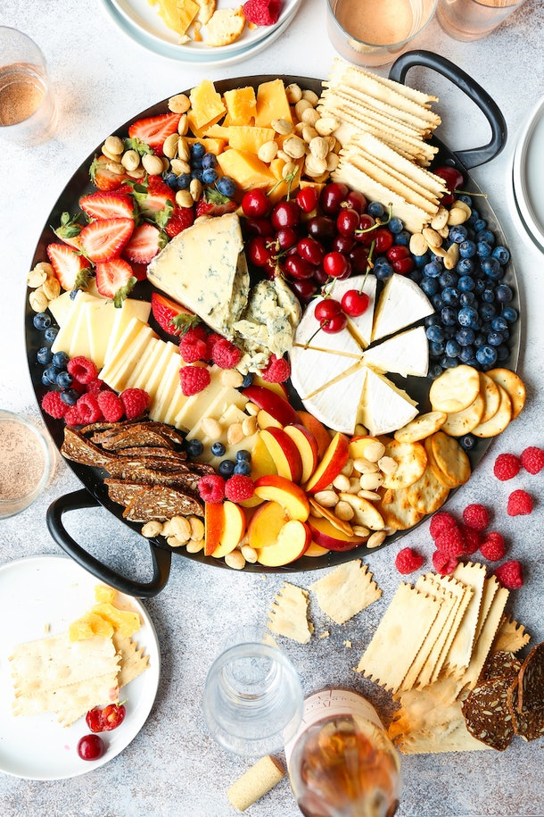 A summer cheese board, like this one from Damn Delicious, is a great summer dinner you can have on the go.