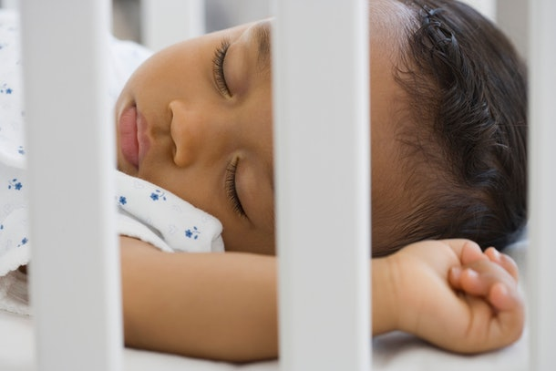 closeup of baby sleeping soundly in crib