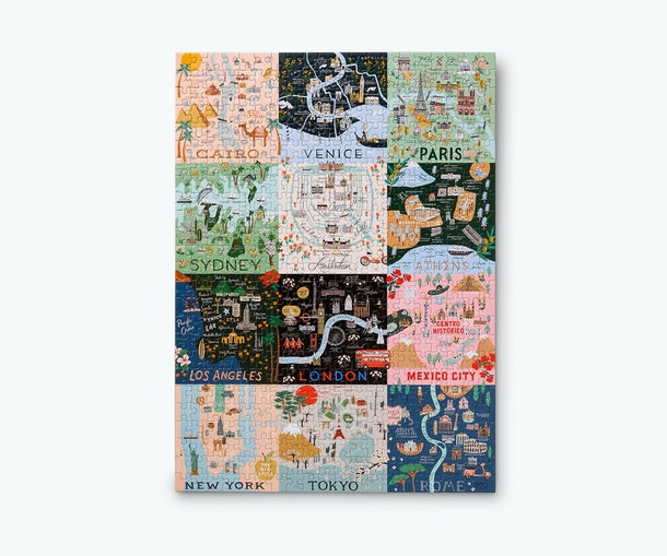 Completed jigsaw puzzle with 12 artistic maps of cities including Rome, Tokyo, New York, Sydney, Amsterdam, and more.