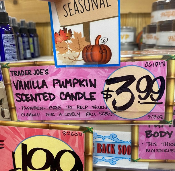 An image of a purple price tag for pumpkin candles reading $4.