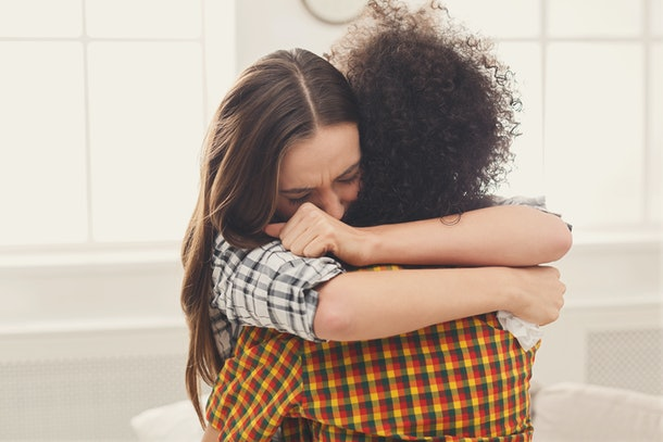 Two friend hugging one another.